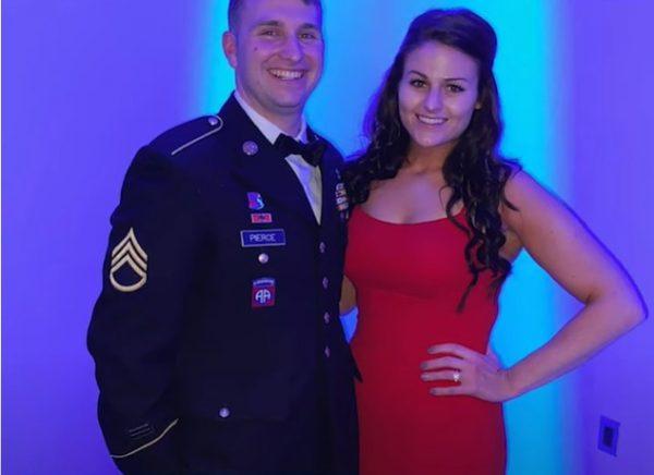 Девушка в красном платье, мужчина - в военной форме