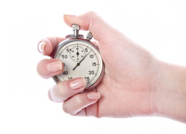 Рука с секундомером