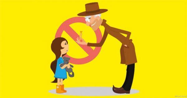 Незнакомец дает конфетку девочке