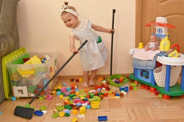 Child puts toys away