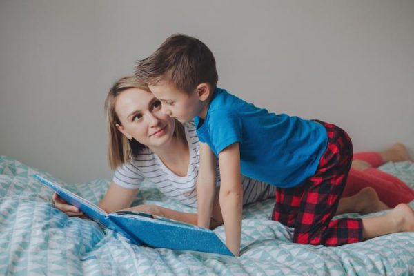 Mom reads to son