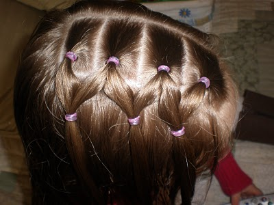 To the right of the parting, we make 4 ponytails.
