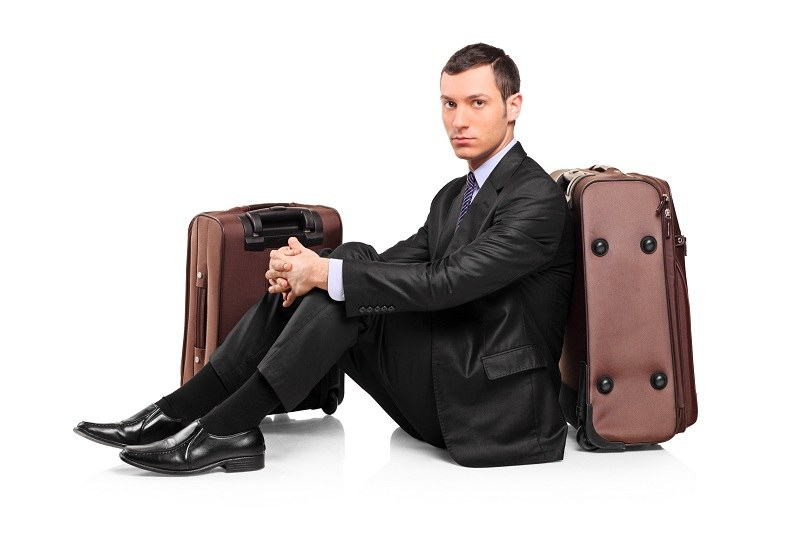 Husband on suitcases