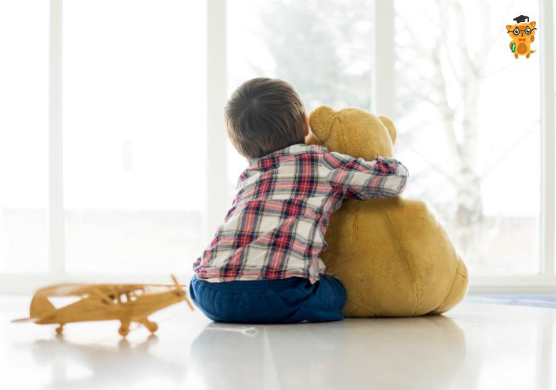 Boy hugs toy