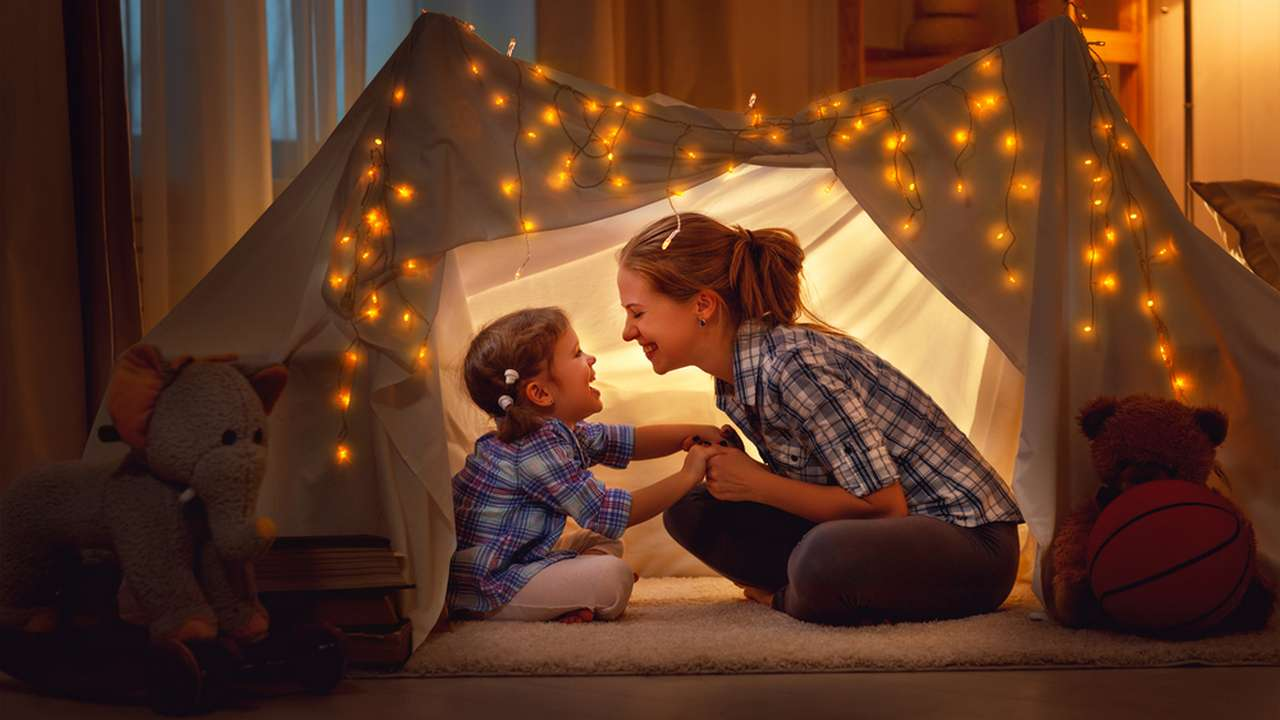 Mom and daughter in a tent