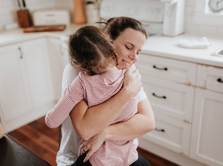 mom hugs baby