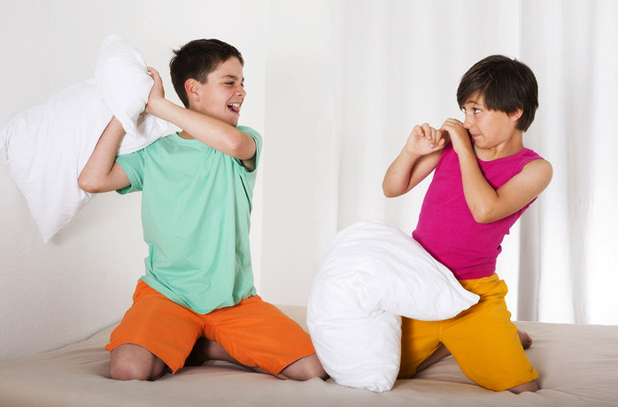 Boys fight with pillows